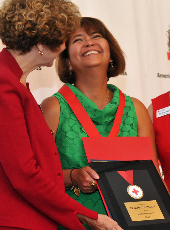 . Bernadette Hensel, right, reacts as she is honored during the Rio Hondo Chapter of the American Red  Hometown Heroes luncheon at the Quiet Cannon in Montebello on Thursday June 27, 2013. (SGVN/Staff Photo by Keith Durflinger)