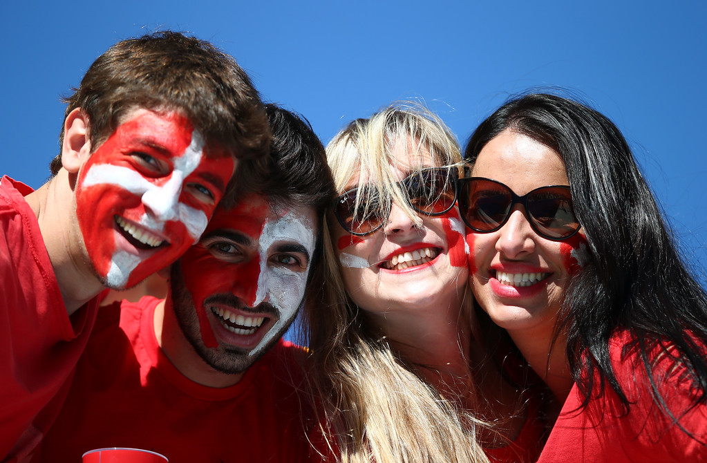 . Switzerland fans pose during the 2014 FIFA World Cup Brazil Round of 16 match between Argentina and Switzerland at Arena de Sao Paulo on July 1, 2014 in Sao Paulo, Brazil.  (Photo by Clive Rose/Getty Images)