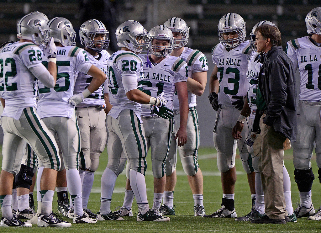 . De La Salle Spartans\' head coach Bob Ladouceur talks to his players during a timeout while playing the Centennial Huskies in the second quarter of the Open Division during the 2012 CIF State Football Championship at Home Depot Center in Carson , Calif. on Saturday, Dec. 15, 2012. (Jose Carlos Fajardo/Staff)