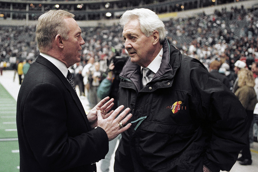 . FILE - In this Jan. 23, 1994, file photo, Dallas Cowboys owner Jerry Jones, left, talks with CBS commentator Pat Summerall before the NFL football NFC championship game between the Cowboys and the San Francisco 49ers in Irving, Texas. Fox Sports spokesman Dan Bell said Tuesday, April 16, 2013, that Summerall, the NFL player-turned-broadcaster whose deep, resonant voice called games for more than 40 years, has died at the age of 82. (AP Photo/Ron Heflin, File)