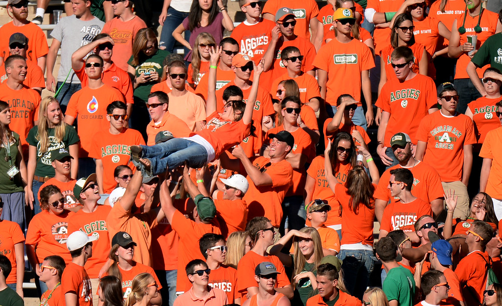 . FORT COLLINS, CO - September 28 : Fans celebrate a touchdown by Rashard Higgins of Colorado State University during the 3rd quarter of the game against University of Texas at El Paso at Hughes Stadium. Fort Collins, Colorado. September 28, 2013. CSU won 59 - 42.(Photo by Hyoung Chang/The Denver Post)