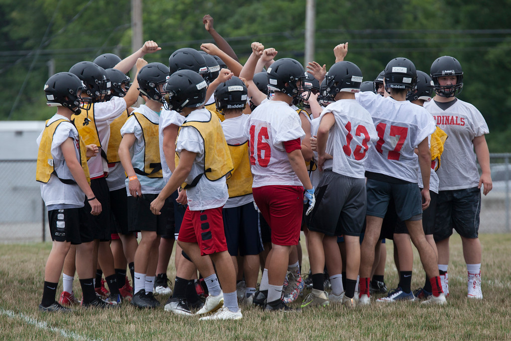 . Jen Forbus - The Morning Journal<br> The Cardinals huddle together as a team before moving on to the next part of practice during Brookside\'s first day of football practice on July 30.