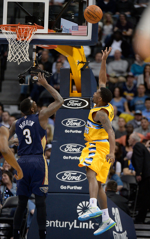 . Denver Nuggets guard Aaron Brooks (0) hits a shot high off the glass for two of his first half 15 points as New Orleans Pelicans guard Anthony Morrow (3) looks on April 2, 2014 at the Pepsi Center in Denver. (Photo by John Leyba/The Denver Post)