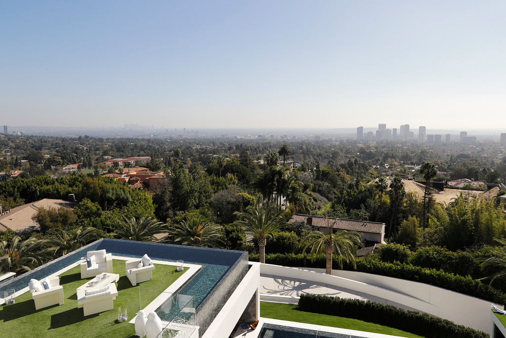 . This Thursday, Jan. 26, 2017, photo shows a balcony off the master bedroom of a $250 million mansion overlooking Los Angeles in the Bel-Air area of Los Angeles. The mansion includes 12 bedroom suites, 21 bathrooms, five bars, three gourmet kitchens, a spa and an 85-foot infinity swimming pool with stunning views of Los Angeles. (AP Photo/Jae C. Hong)