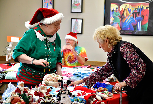 12/7/2018 Mike Orazzi | Staff Nancy Durkin helps Anne Egan find crafts during the New Britain Senior Center's annual Holiday Bazaar Craft Fair on Friday.