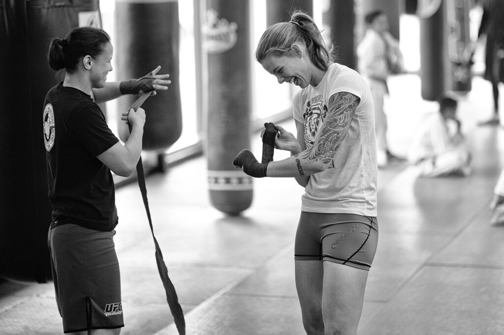 . Shayna Baszler and Jessamyn Duke are all smiles as they wrap their hand before practice at the Glendale Fighting Club in Glendale. (Photo by Hans Gutknecht/Los Angeles Daily News)