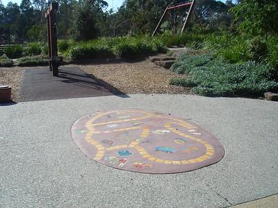 inlaid childrens artwork in concrete path