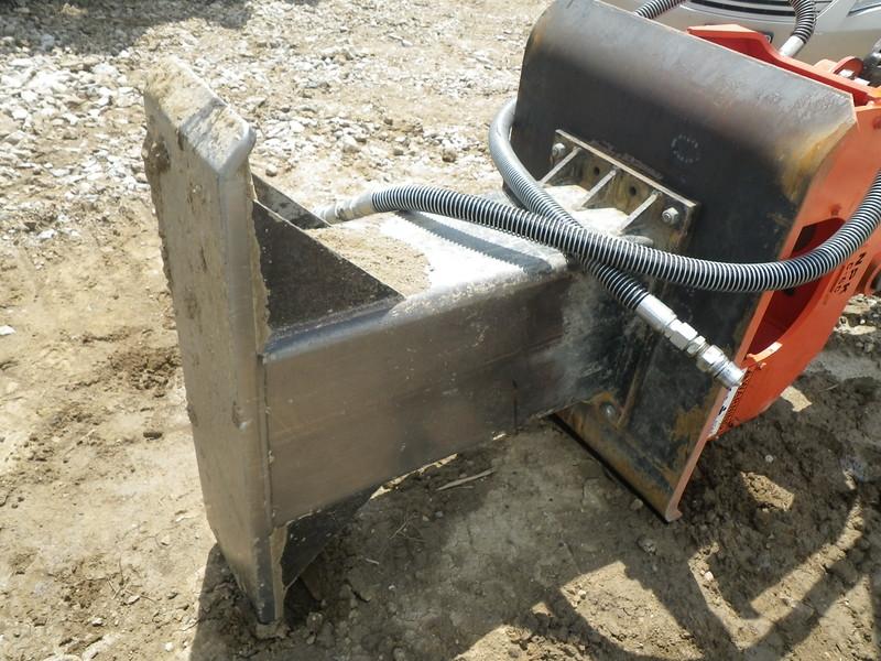 NPK C6C compactor with foot extension on Deere excavator-backfilling deep trench(12).JPG