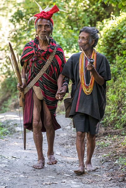 Husband and wife, approximately 70 years old, from the village of Kyardo wearing traditional clothing.  Myanmar 2017