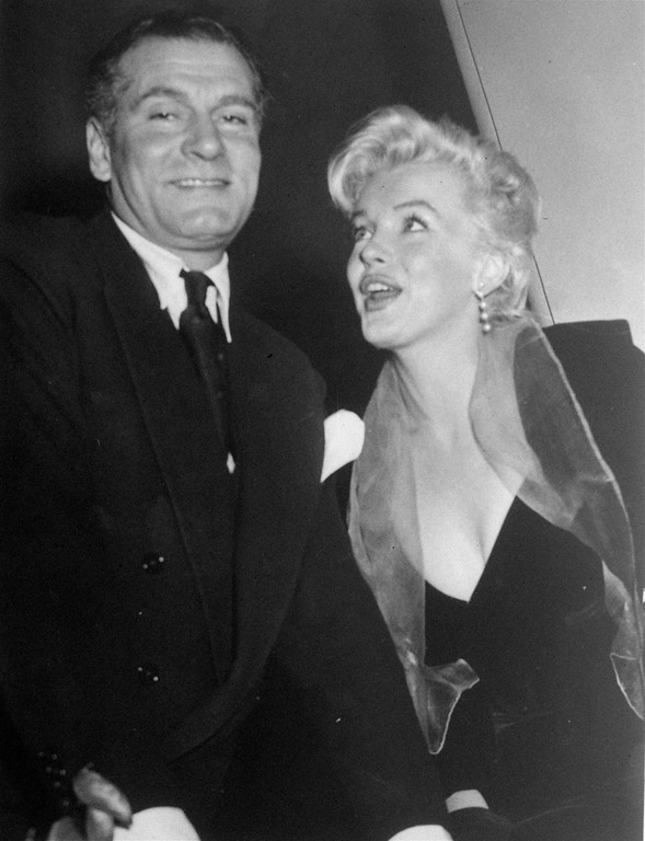 ". Marilyn Monroe and Sir Laurence Olivier reveal their plans to star in a British version of ""The Sleeping Prince,\"" to be called  \""The Prince and the Showgirl.\""  They are seen February 9, 1956 at a press conference in New York City. (AP Photo)"