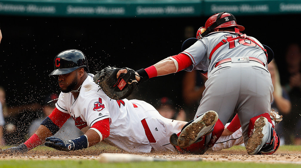. Cleveland Indians\' Carlos Santana (41) is tagged out at home plate by Los Angeles Angels\' Geovany Soto (18) while attempting to score on a single by Mike Napoli during the fifth inning of a baseball game Sunday, Aug. 14, 2016, in Cleveland. (AP Photo/Ron Schwane)