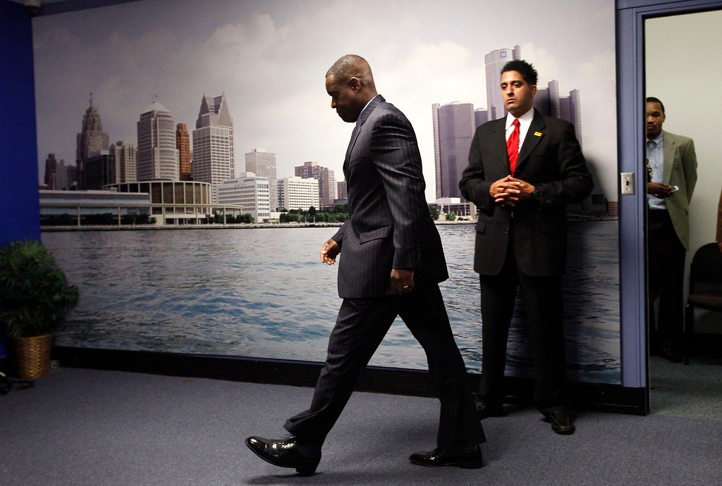 . State-appointed emergency manager Kevyn Orr enters a news conference in Detroit, Mich., Thursday, July 18, 2013. State-appointed emergency manager Kevyn Orr asked a federal judge permission to place Detroit into Chapter 9 bankruptcy protection Thursday. (AP Photo/Paul Sancya)