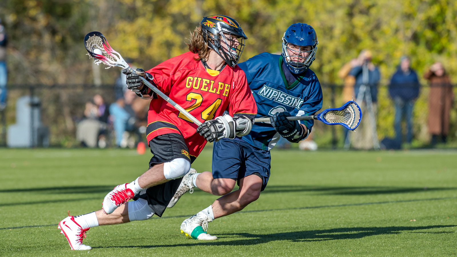two men's lacrosse players