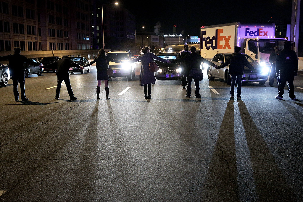. Demonstrators block traffic on Highway I-395 during a protest against a New York grand jury decision December 3, 2014 in Washington, DC. The grand jury decided not to indict police officer Daniel Pantaleo in the death of an unarmed black man, Eric Garner, after putting him in a chokehold.  (Photo by T.J. Kirkpatrick/Getty Images)