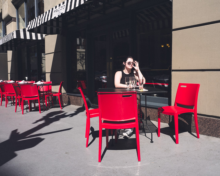 Surrounded by Red Chairs