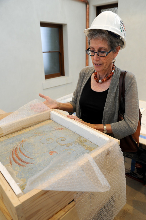 . Glendale Library Administrator Carolyn Flemming shows painted, original ceiling pieces from 1904 that will be framed in Glendale�s historic Brand Library & Art Center. Tuesday, July 23, 2013. (Michael Owen Baker/L.A. Daily News)