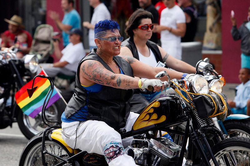 """. Members of the \""""Dykes on Bikes\"""" motorcycle club ride motorcycles at the start of the 43rd annual LA LGBT Pride Parade in West Hollywood, California June 9, 2013. The parade celebrates the lesbian, gay, bisexual and transgender (LGBT) communities in Los Angeles. REUTERS/Patrick T. Fallon"""