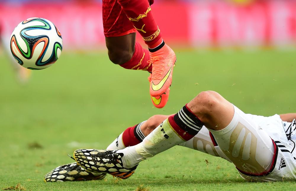 . Ghana\'s defender Harrison Afful (L) vies with Germany\'s defender Benedikt Hoewedes during a Group G football match between Germany and Ghana at the Castelao Stadium in Fortaleza during the 2014 FIFA World Cup on June 21, 2014.  (JAVIER SORIANO/AFP/Getty Images)