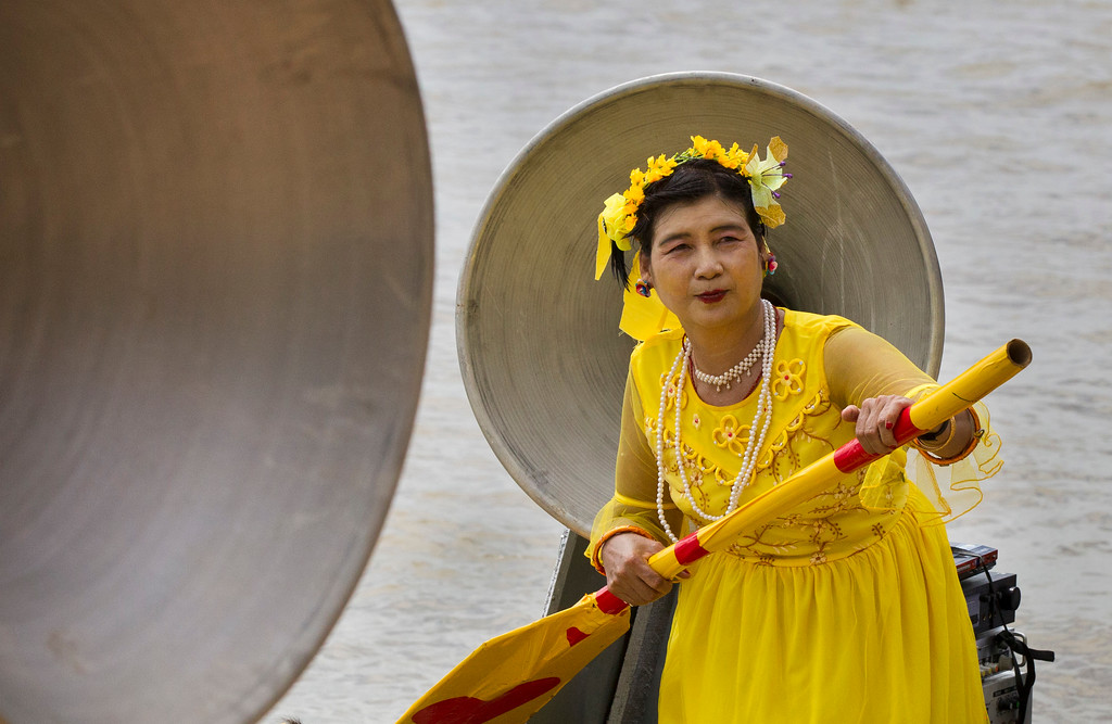 . A woman performs in a cultural competition on a boat during the Shwe Kyin light festival, Friday, Oct. 6, 2017, in Bago, about 183 kms. (114 miles) from Yangon, Myanmar. Men and women from local traditional dancing troupes are taking part in the annual festival, made up of songs, races, and floating candles to celebrate at the end of Buddhist Lent. (AP Photo/Thein Zaw)