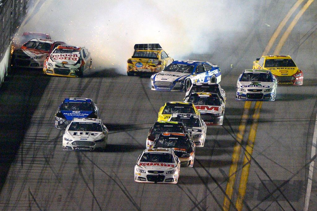 . Dale Earnhardt Jr. (88) escapes a final lap wreck and leads to win the NASCAR Daytona 500 auto race at Daytona International Speedway in Daytona Beach, Fla., Sunday, Feb. 23, 2014. (AP Photo/Phelan M. Ebenhack)