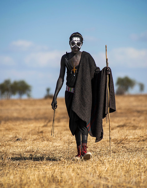 Masai youngster returns home after spending time alone in the wild as part of his rite of passage.   Tanzania, 2019