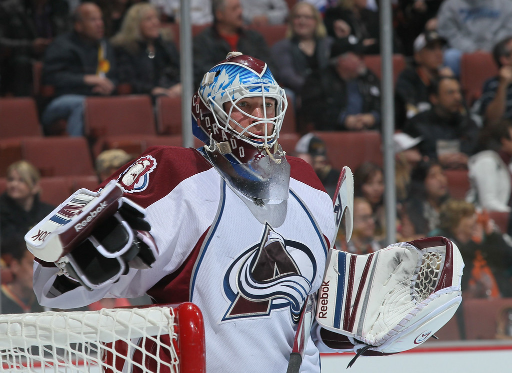 . Goaltender Jean-Sebastien Giguere #35 of the Colorado Avalanche looks on during the NHL game against the Anaheim Ducks at Honda Center on January 22, 2012 in Anaheim, California. The Ducks defeated the Avalanche 3-2.  (Photo by Victor Decolongon/Getty Images)