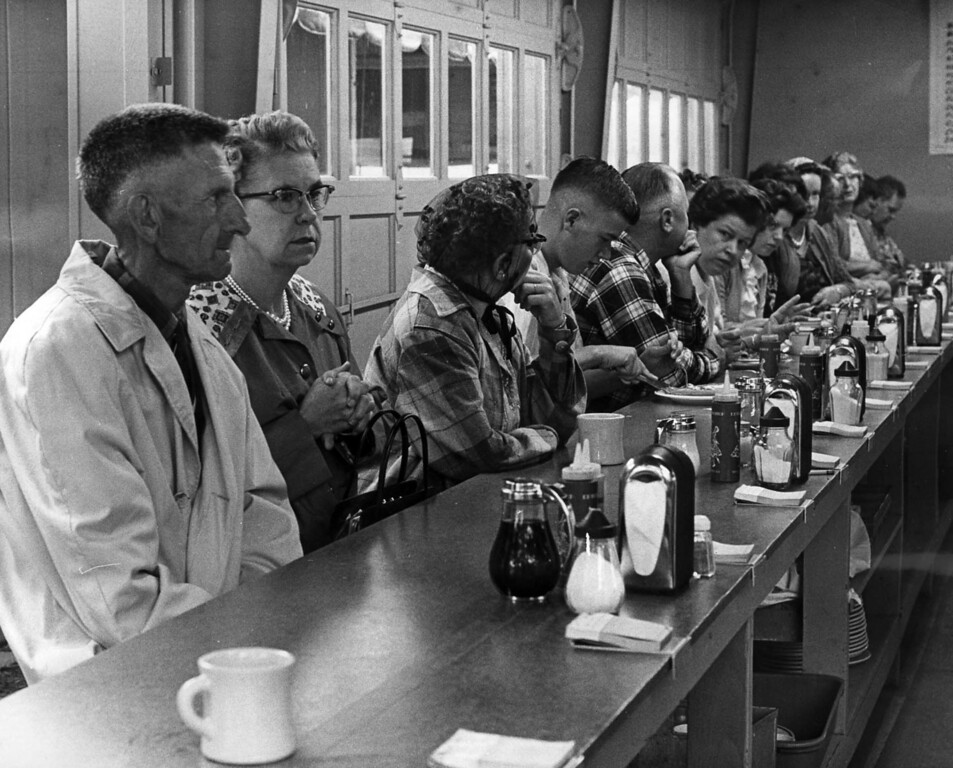 """. \""""The hot food concessions -- especially hot waffles, and such, filled up early with heavily-clad eaters, seeking warmth, within and without\"""" read this caption from a Aug. 24, 1963 St. Paul Dispatch photograph. Photo courtesy of the Minnesota State Fair."""