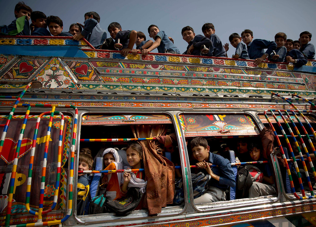 . Pakistani children crowd on a bus after being picked up from school in Wajah Khiel, Swat Valley, Pakistan on Friday, Oct. 4, 2013. Malala Yousufzai\'s battle for girls\' education began when she was barely 11 years old and at a time when the Taliban roamed freely throughout the valley, blowing up schools, beheading security forces and leaving their dismembered bodies in the town square.  (AP Photo/Anja Niedringhaus)