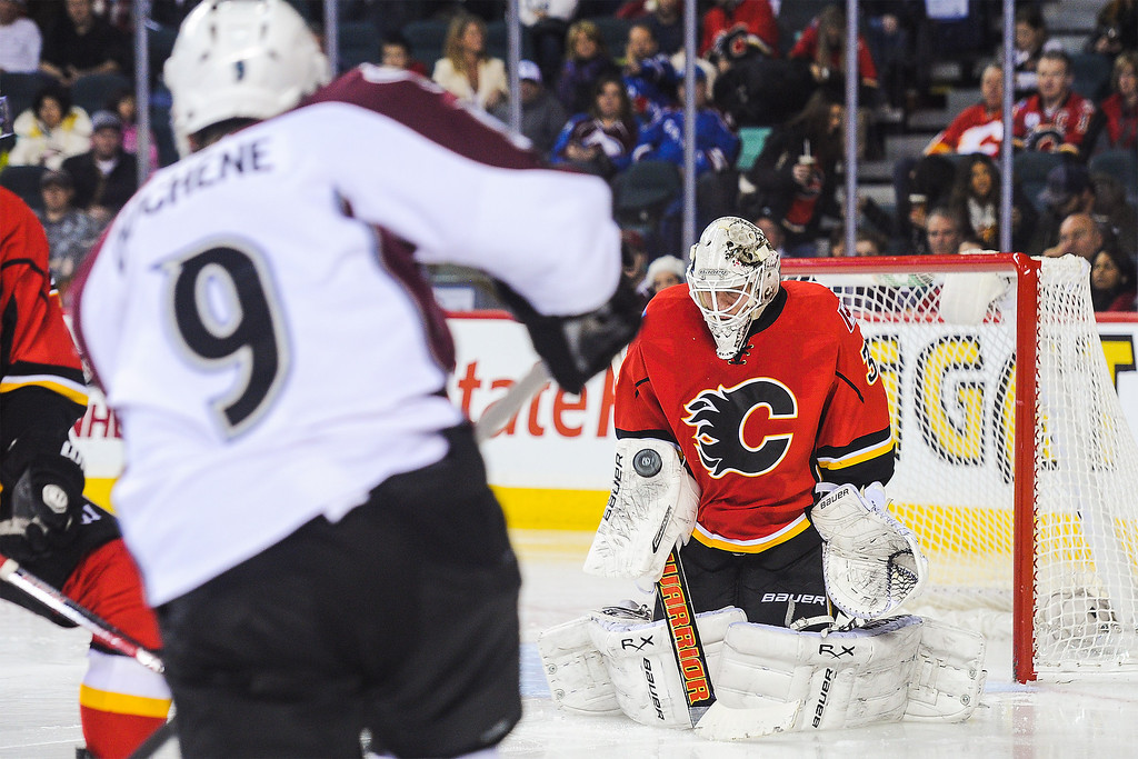 . CALGARY, AB - DECEMBER 6: Karri Ramo #31 of the Calgary Flames stops the shot of Matt Duchene #9 of the Colorado Avalanche during an NHL game at Scotiabank Saddledome on December 6, 2013 in Calgary, Alberta, Canada. (Photo by Derek Leung/Getty Images)