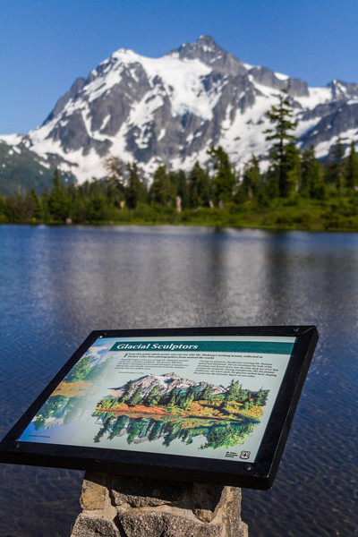 View of snowcapped mountain in front of information board - USA - Washington State - Bellingham