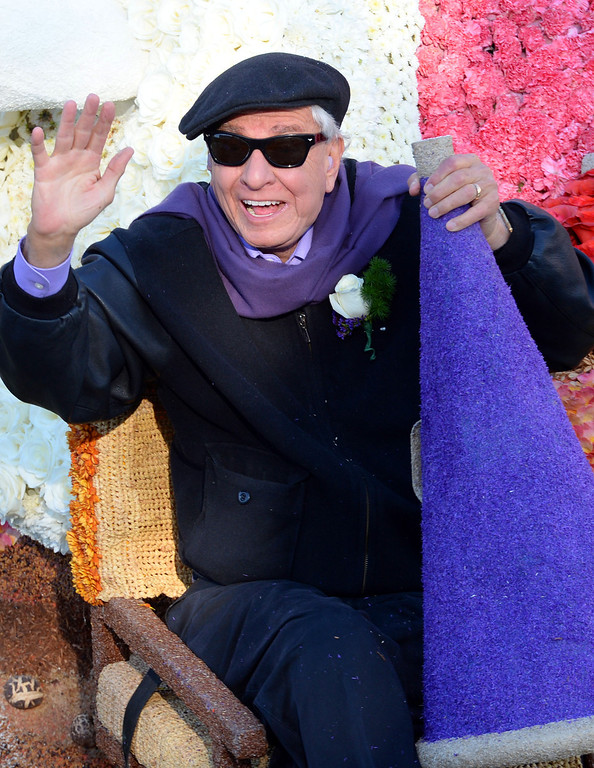 . Garry Marshall rides atop the City of Burbank float during the 2014 Rose Parade in Pasadena, CA January 1, 2014.(Keith Durflinger/San Gabriel Valley Tribune)