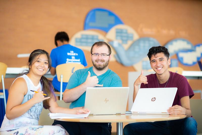 Tamara Rodriguez Acosta(left), Caleb Flowers, and Lawrence Davila are studying at University Center.