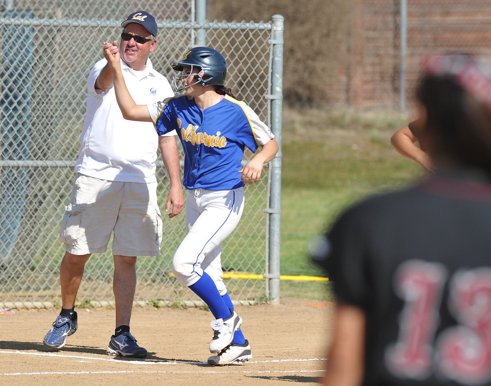 . California\'s Trisha Trujillo (#24) is congratulated by coach Jim Kruse after hitting a three-run homerun as they play Bell Gardens in their non-league game at California High School in Whittier on Thursday March 14, 2013. California beat Bell Gardens 10-0 in five innings. (SGVN/Staff Photo by Keith Durflinger)