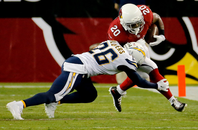. Arizona Cardinals running back Jonathan Dwyer (20) is hit by San Diego Chargers defensive back Brandon Flowers (26) during the first half of an NFL football game, Monday, Sept. 8, 2014, in Glendale, Ariz. (AP Photo/Matt York)