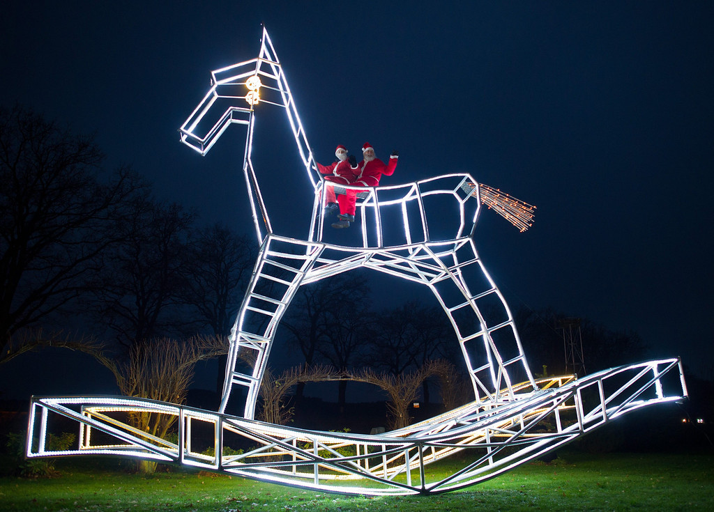 . Bike designer Dieter (Didi) Senft presents with his grandson Tom a reindeer with 6,312 LED lamps in Storkow, Germany, 27 November 2013. The construction is 8.12 meters high, 9.11 meters long and 3.36 meters wide.  EPA/PATRICK PLEUL