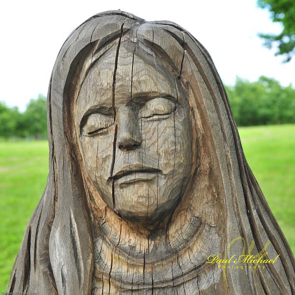 Sad portrait.  Amazing wood grain.
