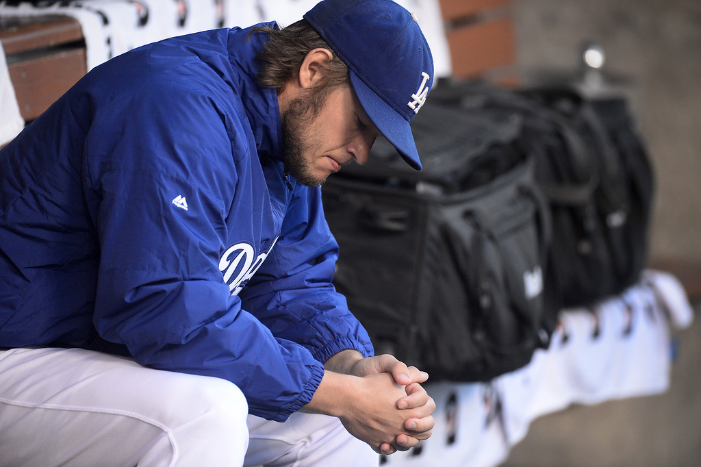 . Los Angeles Dodgers\' Clayton Kershaw sits in the dugout before they play the Atlanta Braves during game 4 of the NLDS at Dodger Stadium Monday, October 7, 2013. (Photo by Sarah Reingewirtz/Los Angeles Daily News)