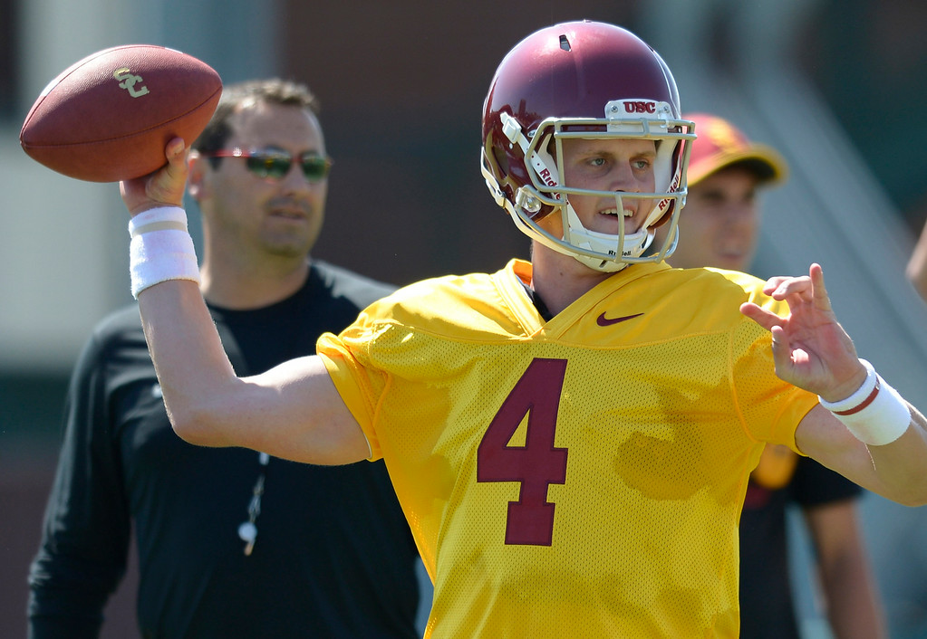 . QB Max Browne throws the ball under the watchful eye of coach Steve Sarkisian. Football practice is in full swing on the Howard Jones Field at USC. Los Angeles, CA. 8/6/2014(Photo by John McCoy Daily News)