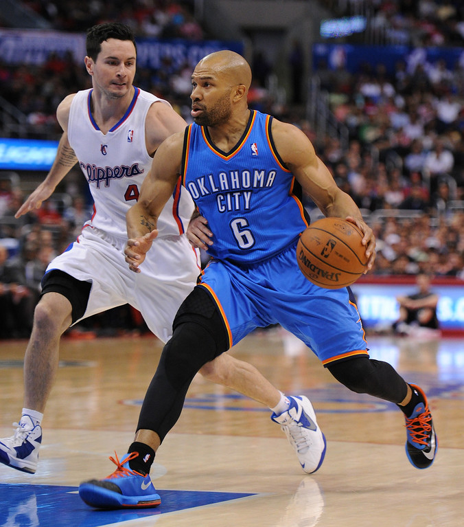 . Clippers#4 J.J. Redick guards Thunder#6 Derek Fisher. The Oklahoma City Thunder defeated the Clippers 107-101 in a regular season game at Staples Center in Los Angeles, CA. 4/9/2014(Photo by John McCoy / Los Angeles Daily News)