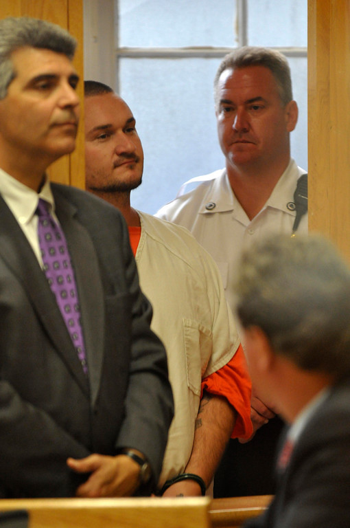 . Adam Lee Hall, 34 , is arraigned in Berkshire District Court on charges of murder and kidnapping of three Pittsfield, Ma men.  Hall was charged with Caius Veiovis and David Chalue after the bodies of David Glasser, Edward Frampton and Robert Chadwell were discovered over the weekend.  Pittsfield, Monday September 12, 2011 (Ap Photo by Ben Garver, The Berkshire Eagle)
