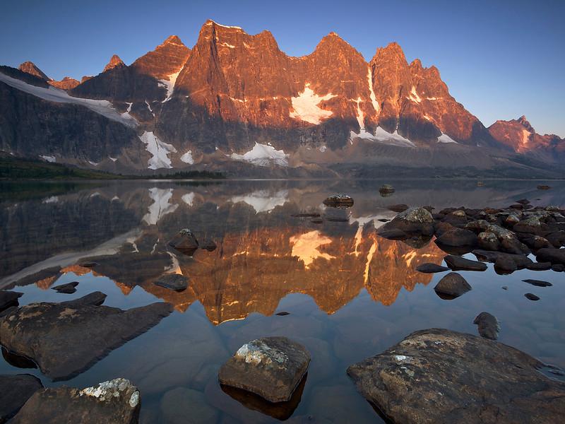 Canada, Alberta, Jasper NP, The Ramparts reflected in Amethyst Lake at sunrise