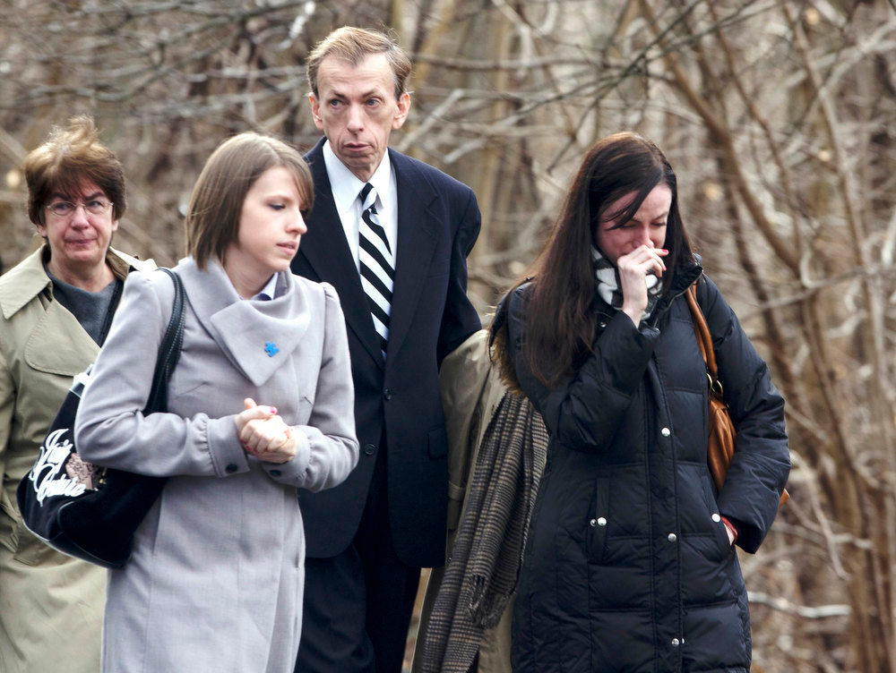 . Mourners leave the funeral mass for Rachel Marie D\'Avino at the Church of the Nativity in Bethlehem, Connecticut, December 21, 2012. D\'Avino was a victim of the December 14 shootings at Sandy Hook Elementary School in Newtown, Connecticut.  REUTERS/Michelle McLoughlin