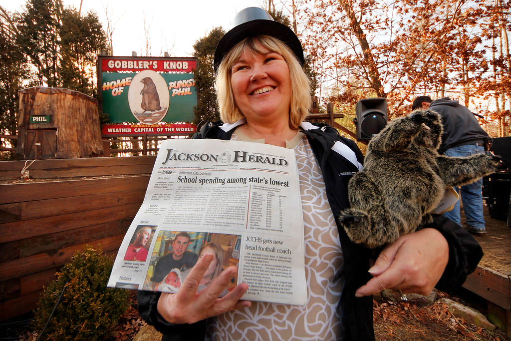 . Runelle Pursley of Jefferson, Ga., stands at Gobbler\'s Knob on Groundhog eve, Feb. 1, 2012, after driving more than 700 miles to spend Groundhog day with weather forecasting groundhog Punxsutawney Phil in Punxstawney, Pa. (AP Photo/Gene J. Puskar)