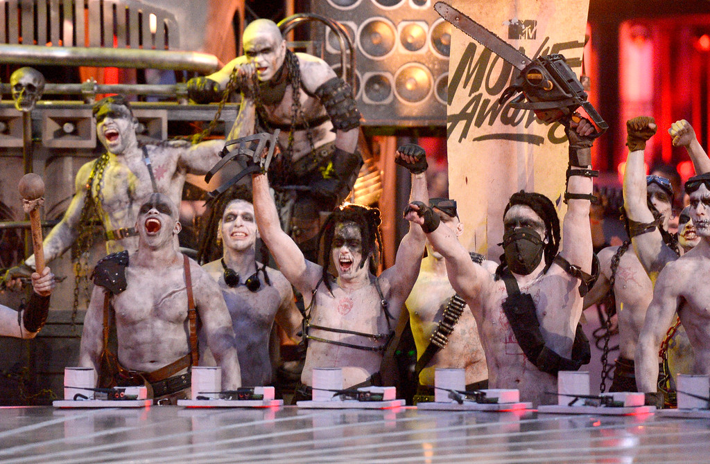 . War Boys, characters from Mad Max, appear at the MTV Movie Awards at Warner Bros. Studio on Saturday, April 9, 2016, in Burbank, Calif. (Kevork Djansezian/Pool Photo via AP)