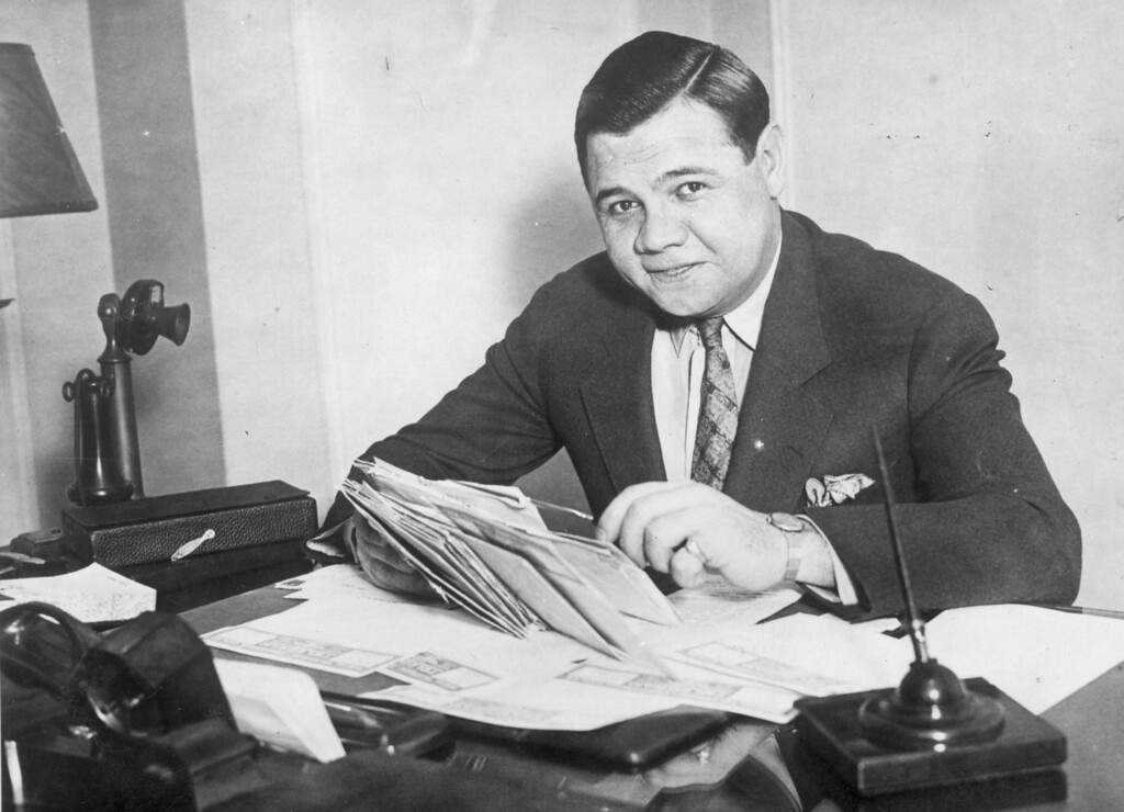 . circa 1935:  Babe Ruth (George Herman Ruth, 1895 - 1948) American professional baseball player signs a new two year contract with the \'New York Yankees\'.  (Photo by General Photographic Agency/Getty Images)
