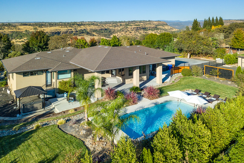 Drone-View-of-house-and-pool-with-canyon-background.jpg