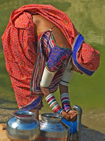 BUHR_WAYNE_WOMEN WASHING HANDS,KUTCH,INDIA.jpg