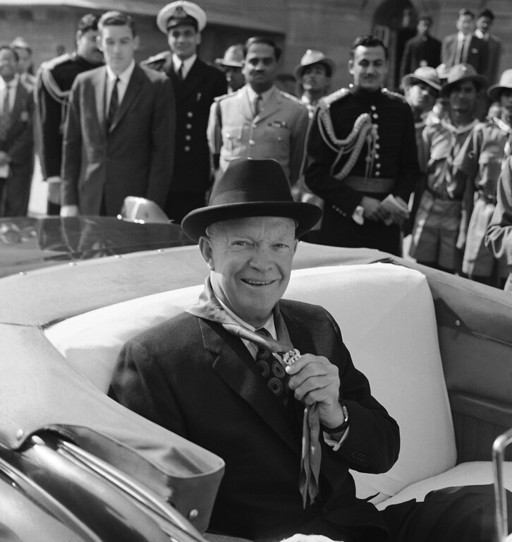 . 1959: Dwight D. Eisenhower. President Dwight D. Eisenhower holds elephant clasp on scarf presented to him by Scouts in New Delhi on Dec. 10, 1959 during his goodwill tour of India. (AP Photo)