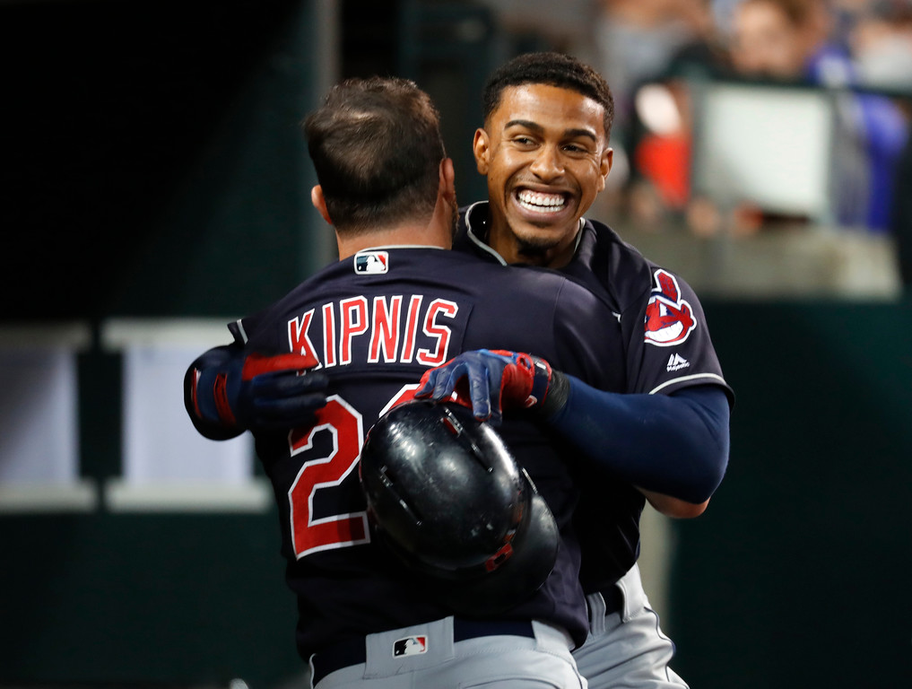 . Cleveland Indians\' Francisco Lindor, right, celebrates his solo home run with Jason Kipnis (22) in the ninth inning of a baseball game against the Detroit Tigers in Detroit, Friday, July 27, 2018. (AP Photo/Paul Sancya)