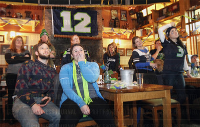 SLUG:  SUPER-BOWL-SEAHAWKS-PATRIOTS-Seattle-biz-scene